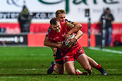 Scarlets' Steffan Hughes is tackled by Dragons' Jarryd Sage<br /> <br /> Photographer Craig Thomas/Replay Images<br /> <br /> Guinness PRO14 Round 13 - Scarlets v Dragons - Friday 5th January 2018 - Parc Y Scarlets - Llanelli<br /> <br /> World Copyright © Replay Images . All rights reserved. info@replayimages.co.uk - http://replayimages.co.uk