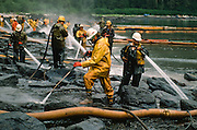 Alaska. Prince William Sound. King Island. Steam cleaning following the Exxon Valdez oil spill on a remote beach.