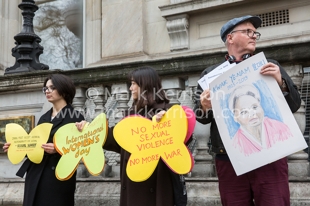 London, UK. 8th March, 2019. Campaigners from Justice For Comfort Women UK stand outside the Japanese embassy on International Women's Day in solidarity with the 'Comfort Women', over 200,000 girls and women used as sex slaves by the Japanese Imperial Army during the Second World War, to remember those who have since passed away and to call on the Japanese government to offer a sincere apology.