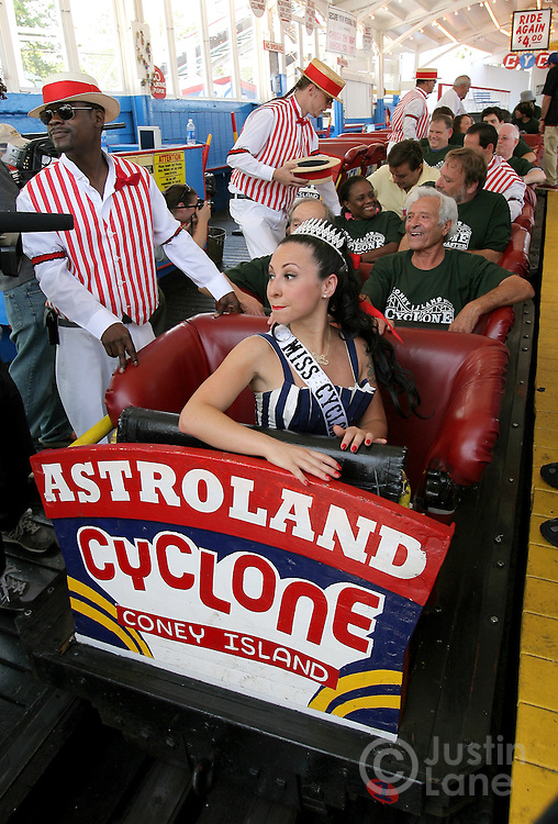 Angie Pantani (C), also know as 'Miss Cyclone', prepares to ride the Cyclone roller coater during the 80th anniversary celebration of the famous ride's first run in the Coney Island area of Brooklyn, New York on 26 June 2007. Joining her on the ride were two octogenarian roller coaster aficionados, Louis Picariello (R), of Belingham, Massachusetts, and Ed Murman (behind Pantani), of Smithtown, New York.