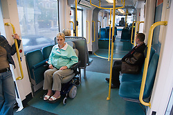Woman wheelchair user travelling on the tram,