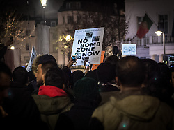 December 13, 2016 - London, London, United Kingdom - Image ¬©Licensed to i-Images Picture Agency. 13/12/2016. London, United Kingdom. Aleppo is Dying Protest. ..A banner with ''No Bomb Zone Now'' is held up as over 1000 protesters gathered outside the Syrian Embassy in London...As well as voicing their anger at the current dire situation for civilians in the war torn city of Aleppo and speaking out against Bashar al-Assad's regime, Muslim prayers were held at the ''emergency demo.'' ..Picture by Pete Maclaine / i-Images (Credit Image: © Pete Maclaine/i-Images via ZUMA Wire)