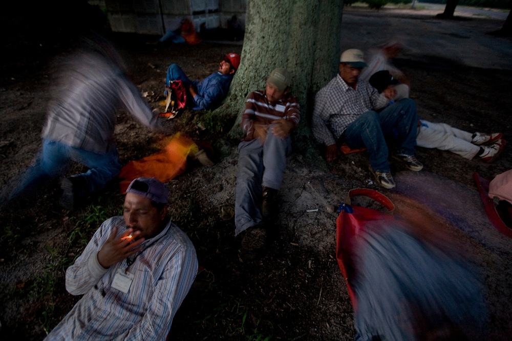 Just before 6 A.M. Fransisco Yanez of Hidalgo, Mexico takes a final drag of a cigarette before joining fellow workers in picking peaches. Yanez, who is married and has two children has worked at Titan Farms for 11 years. His brother and son also work on the farm.