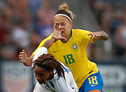 US's forward Crystal Dunn (front) fouls Brazil's forward Thais during the Tournament of Nations women's football match between Brazil and the US in Bridgeview, Illinois.