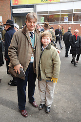 The EARL OF CARNARVON and his son the HON.EDWARD HERBERT at the Hennessy Gold Cup 2010 at Newbury Racecourse, Berkshire on 27th November 2010.