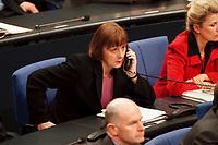 20 JAN 2000, BERLIN/GERMANY:<br /> Angela Merkel, CDU Generalsekretärin, telefoniert, während der Debatte zur CDU Spendenaffäre, Plenum, Deutscher Bundestag<br /> Angela Merkel, General Secretary of the Christian Democratic Union, with a telephone, during the debate about the affair of secret donations to the CDU<br /> IMAGE: 20000120-01/03-05<br /> KEYWORDS: Telefon, phone