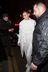 Bella Hadid leaving her hotel with Moncler coat, Alexander Wang socks and Nike air Max sneakers, total white look to Costes Hotel during the Paris fashion week on February 27, 2018 in Paris, France. Photo by Nasser Berzane/ABACAPRESS.COM
