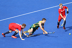 Austin Smith of South Africa tries to evade the tackle of Jonty Clarke of Great Britain during the men's hockey match between South Africa and Great Britain held at the Riverbank Arena at Olympic Park in London as part of the London 2012 Olympics on the 1st August 2012..Photo by Ron Gaunt/SPORTZPICS