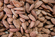 A pile of freshly roasted almonds