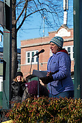 Bar Harbor, Maine, USA. 19 January, 2019. Joy O'Shaugnessy addresses the crowd gathered on the Village Green for the Women's March Bar Harbor, a sister march of the national Women's March.