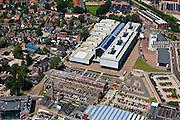 Nederland, Overijssel, Hengelo, 30-06-2011; Lansinkveld onderdeel van het Hart van Zuid. De fabriekshal van voormalige gieterij van Stork, nu ROC Twente.  Het voormalig Hijsch-complex, waarvan de spanten nog staan, is parkeerterrein. Het gebouw met de toren is de Brandweerkazerne. .Lansinkveld, part of the 'Heart of South' development scheme. The former foundry of Stork is now ROC Twente (technical and vocational training). The former Hijsch complex, its rafter still standing, is used for parking. The building with the tower is the new fire station..luchtfoto (toeslag), aerial photo (additional fee required).copyright foto/photo Siebe Swart