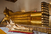 Reclining Buddha at Wat Poramaiyikawat - Wat Poramaiyikawat, at the north-east corner right next to the ferry landing at Ko Kret. The main temple on the island, this old monastery is constructed in Mon (Burmese) style and is a focal point of Thailand's small Mon community: both the scriptures and the daily prayers here are in Mon. The ubosoth is decorated in Italian marble brought in by King Rama V, and a wooden pagoda near the pier houses the remains of one of the abbots. The white, Burmese-style stupa, modeled on Phra Tat Chedi Mutao in Hongsawadi, Myanmar, is said to contain the Buddha's relics.