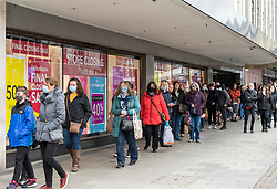 © Licensed to London News Pictures;12/04/2021; Bristol, UK. People queue for the closing down sale at Debenhams in Broadmead as lockdown restrictions are eased to allow non-essential shopping on Monday 12 April during the Covid-19 coronavirus pandemic in England. Photo credit: Simon Chapman/LNP.