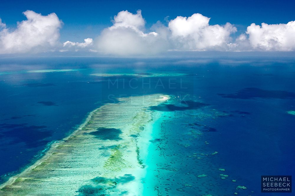 An aerial photograph of Michaelmas Cay, with Michaelmas Cay in the foreground.<br /> <br /> Open Edition Print / Stock Image