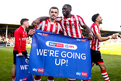 John Akinde and Harry Toffolo celebrate winning promotion from Sky Bet League Two to Sky Bet League One - Mandatory by-line: Robbie Stephenson/JMP - 13/04/2019 - FOOTBALL - Sincil Bank Stadium - Lincoln, England - Lincoln City v Cheltenham Town - Sky Bet League Two