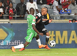 Luvuyo Memela of Orlando Pirates battle for the ball with Deon Hotto of Bloemfontein Celtic during the ABSA premiership league at Orlando stadium, Soweto.<br />Picture: Itumeleng English/ African News Agency /ANA<br />04.04.2018<br />348<br />Picture: Itumeleng English/ African News Agency /ANA