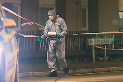 © Licensed to London News Pictures. 06/03/2019. London, UK.  A forensic officer at the crime scene in North Birkbeck Road in Leyton where a murder investigation has been launched after a man was stabbed this afternoon at around 16:26hrs.  Photo credit: Vickie Flores/LNP
