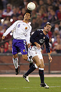 10 February 2006: Japan's Mitsuo Ogasawara (8) beats US midfielder Chris Klein (right) for a header. The United States Men's National Team defeated Japan 3-2 at SBC Park in San Francisco, California in an International Friendly soccer match.