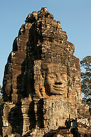 Bayon Lokesvara - The Bayon's most distinctive feature is the multitude of serene and massive stone faces on the many towers which jut out from the upper terrace and cluster around its central peak. The temple is known also for two impressive sets of bas-reliefs, which present an unusual combination of mythological, historical, and mundane scenes.