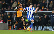 Brighton central defender, Lewis Dunk (5) races for the ball with Hull City striker Abel Hernandez (9) during the Sky Bet Championship match between Hull City and Brighton and Hove Albion at the KC Stadium, Kingston upon Hull, England on 16 February 2016.