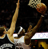 PHOTO BY DAVID RICHARD.LeBron James puts up a layup against the defense of Rasho Nesterovic last night in the second quarter.