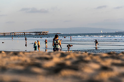 Tourists and locals gather for sunset along Venice Beach, California October 9, 2014. (Photo by Ami Vitale)