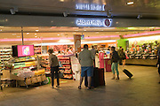 People shopping at Albert Heijn supermarket shop in the central railway station, Rotterdam, Netherlands