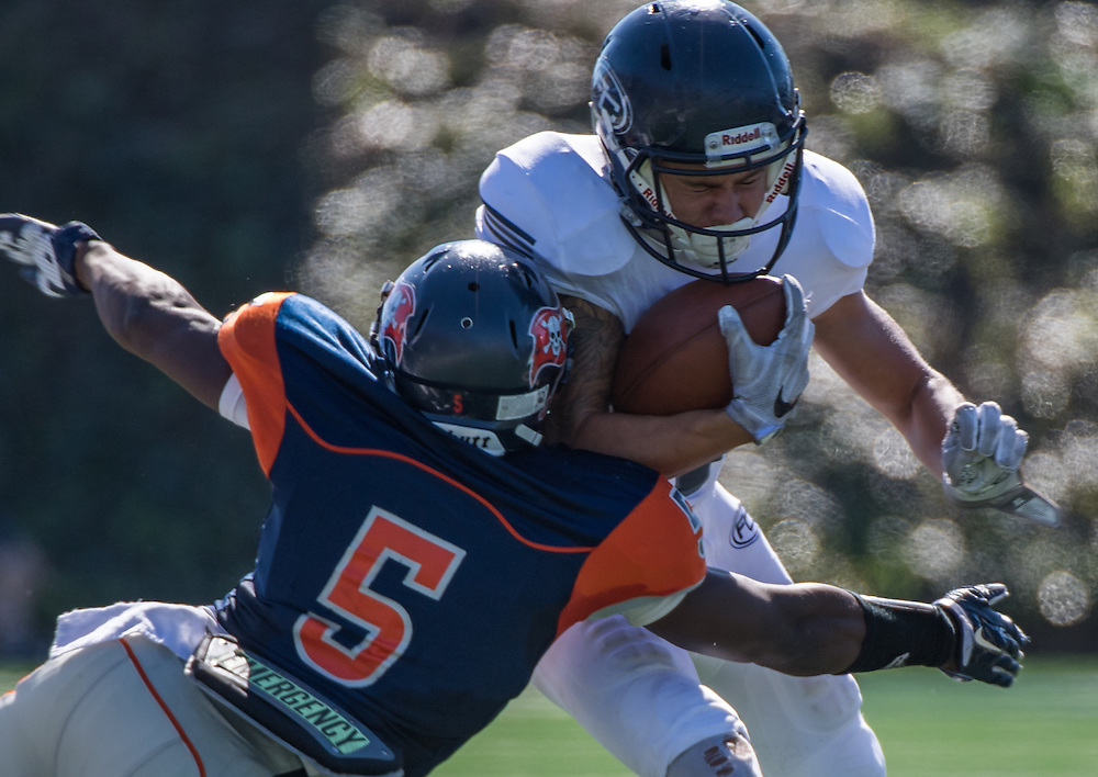 Orange Cost College Semaj Bilal#5makes a play on the ball with a big hit on Markus Grossman #13 of Fullerton on Saturday November 5 at Lebard Stadium