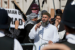 © London News Pictures. Anjem Choudary (C) and Siddhartha Dhar (R using camera) at a Muslims Against Crusades demonstration outside the American Embassy in Grosvenor Square on the tenth anniversary of the 9/11 attacks in London on September 11, 2011. There has been speculation that Siddhartha Dhar is this the new 'Jihadi John', who appeared in a recent ISIS video. Photo credit: LNP