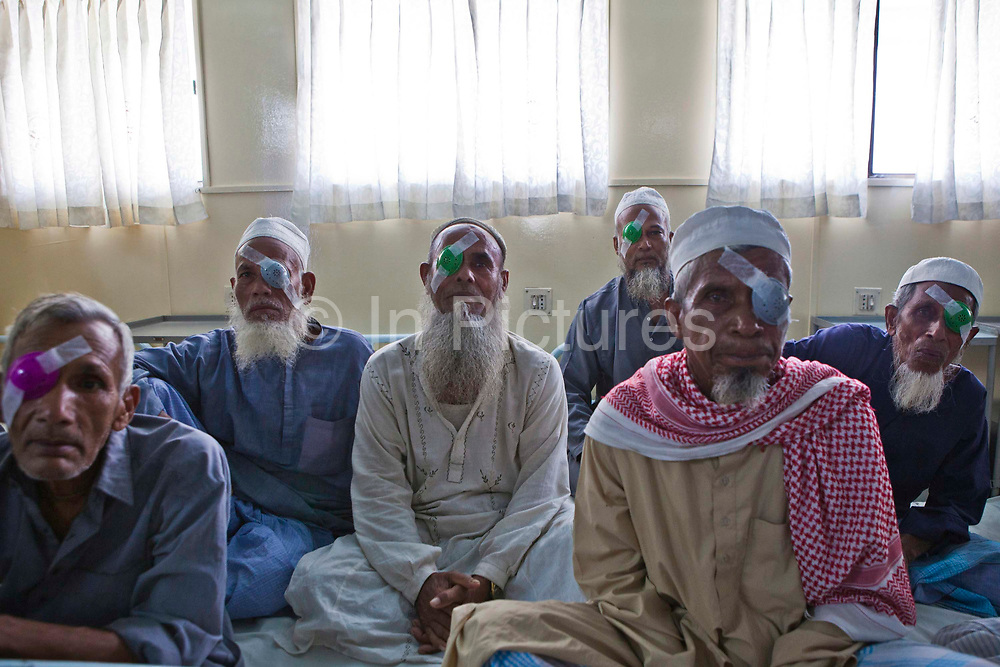Patients wait to see the doctor  for an eye examination after receiving Cataracts surgery the evening before on the IFB Jibon Tari Floating Hospital moored up on the banks of the Modhumoti River.  The Jibon Tari normally moves location every 3 months to remote riverine and offshore areas. It was launched in 1999 and has been major success, reaching more that 200,000 people.<br /> Impact Foundation Bangladesh (IFB) provide care, support and treatment to people with disabilities in Bangladesh.