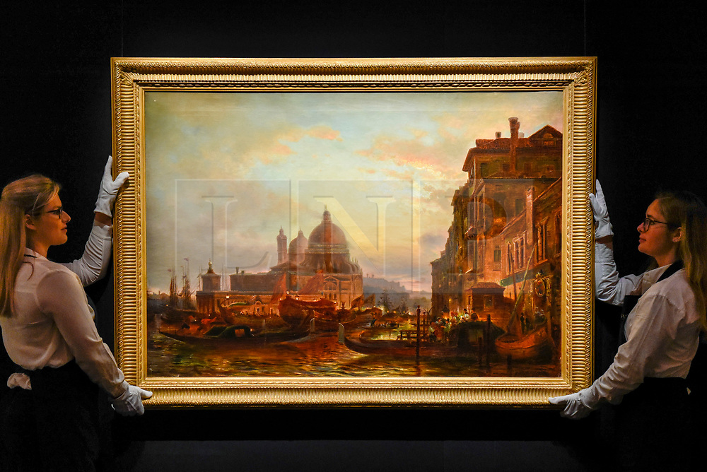 """© Licensed to London News Pictures. 22/11/2019. LONDON, UK. Technicians present """"Venice at Dusk"""" by Alexei Bogoliubov (Est. GBP400-600k) at the preview for the upcoming sales of Russian artworks at Sotheby's New Bond Street.  The Russian Pictures and Works of Art, Fabergé and Icons sales take place on 26 November.  Photo credit: Stephen Chung/LNP"""