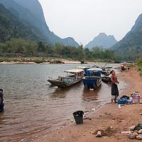 Women washing their clothes at a river bank in Muang Ngoi Neua.