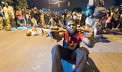 September 22, 2016 - Charlotte, North Carolina, United States of America - September 22, 2016 - Charlotte, NC, USA - Protestors lie in the street during a third day of protests in Charlotte, North Carolina on Thursday, Sept. 22, 2016. This is the third day of protests that erupted after a police officer's fatal shooting of an African-American man Tuesday afternoon and the first full day of a declared State of Emergency by the governor. (Credit Image: © Sean Meyers via ZUMA Wire)