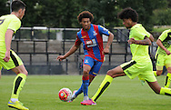 Keshi Anderson plays a through ball during the U21 Professional Development League match between Crystal Palace U21s and Huddersfield U21s at Imperial Fields, Tooting, United Kingdom on 7 September 2015. Photo by Michael Hulf.