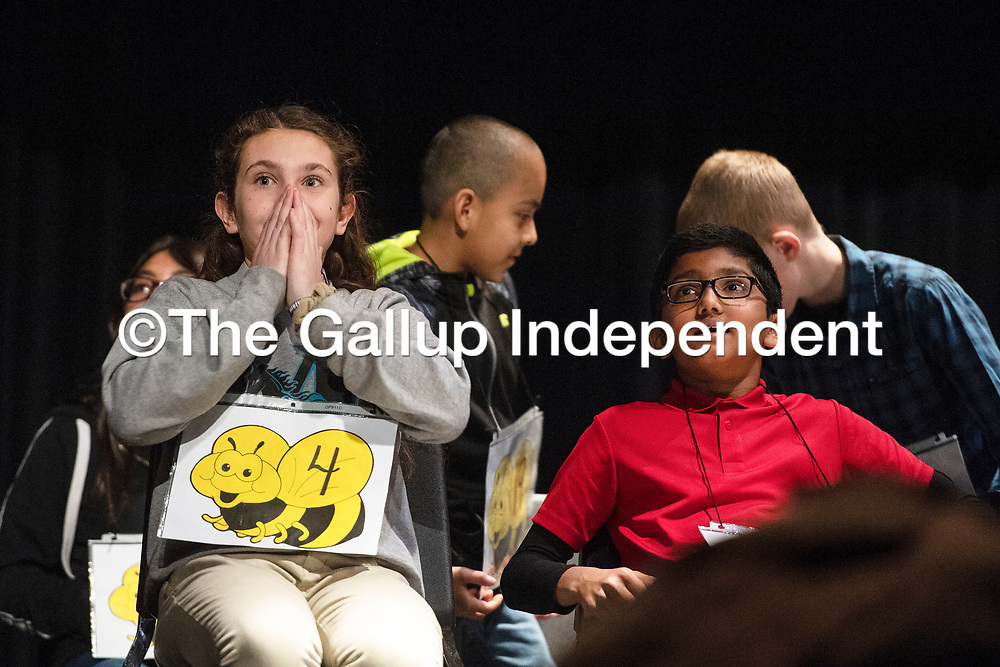 Amalia Wagner, 12, left, from Gallup Middle School and Srikar Venigalla, 10, right, from Red Rock Elementary school react to news that they are the last two students competing for first place in the Gallup-McKinley County Schools spelling bee, Wednesday, Jan. 16 at Gallup High School. Wagner won first place in the ninth round. Both first and second place go on to compete in the state spelling bee at Sandia Prep in March.