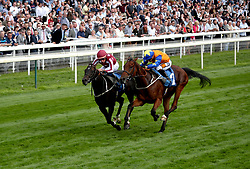Baghdad (left) ridden by jockey William Buick on the way to winning the 7IM Supports Cystic Fibrosis Care Handicap alongside Making Miracles (right) ridden by jockey Silvestre de Sousa during day three of the 2018 Dante Festival at York Racecourse.