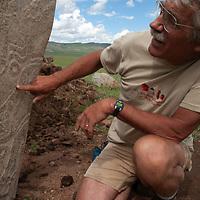 MONGOLIA. Dr. William Fitzhugh studies 2700+ year-old, bronze age Deer Stones and khirigsur burial mounds at Ulaan Tolgai site near Lake Erkhel & Muren.