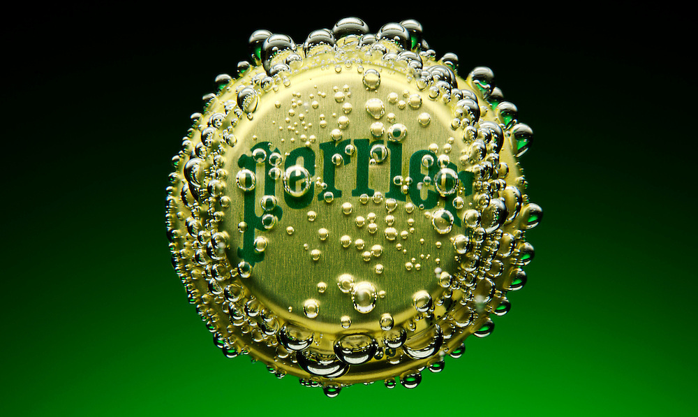 Perrier bubbles permeating bottle cap in front of green background Ray Massey is an established, award winning, UK professional  photographer, shooting creative advertising and editorial images from his stunning studio in a converted church in Camden Town, London NW1. Ray Massey specialises in drinks and liquids, still life and hands, product, gymnastics, special effects (sfx) and location photography. He is particularly known for dynamic high speed action shots of pours, bubbles, splashes and explosions in beers, champagnes, sodas, cocktails and beverages of all descriptions, as well as perfumes, paint, ink, water – even ice! Ray Massey works throughout the world with advertising agencies, designers, design groups, PR companies and directly with clients. He regularly manages the entire creative process, including post-production composition, manipulation and retouching, working with his team of retouchers to produce final images ready for publication.