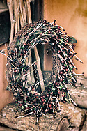 Christmas wreath decoration in a cottage porch in England