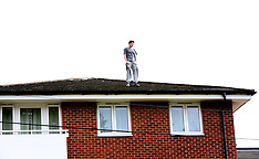 Man on Roof Stand