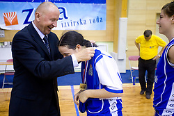 Dusan Sesok and Nika Baric at cup ceremony at finals match of Slovenian 1st Women league between KK Hit Kranjska Gora and ZKK Merkur Celje, on May 14, 2009, in Arena Vitranc, Kranjska Gora, Slovenia. Merkur Celje won the third time and became Slovenian National Champion. (Photo by Vid Ponikvar / Sportida)