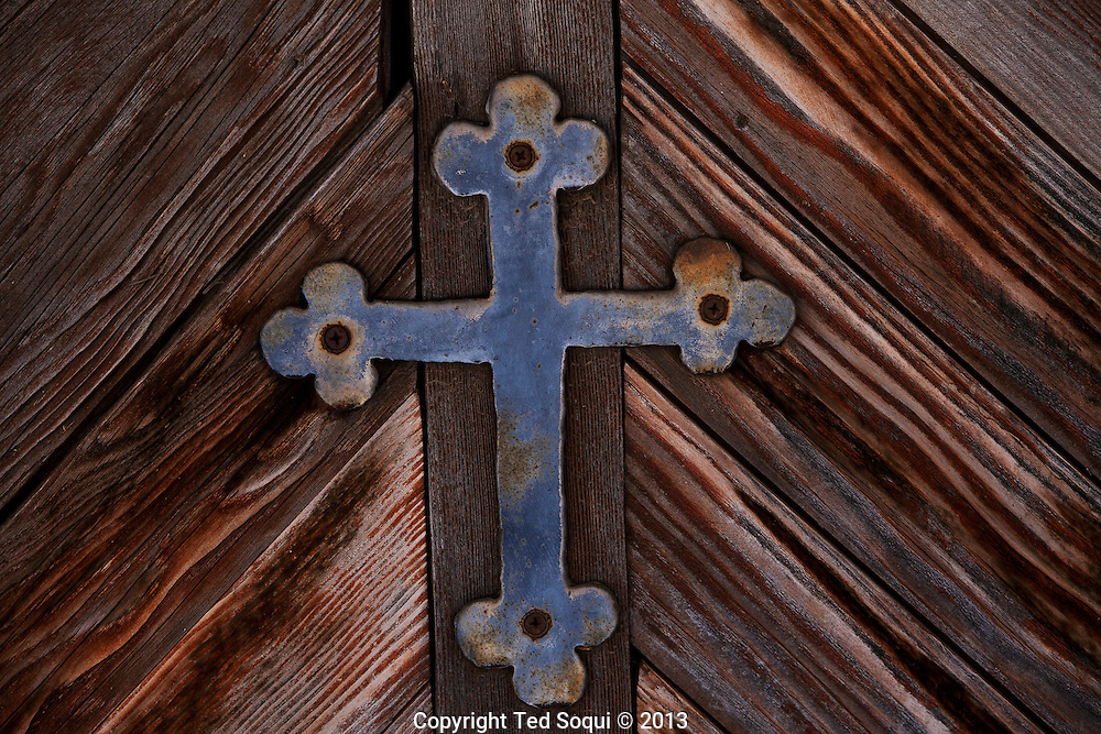 Winter in New Mexico..A hand made cross on a old church in Taos, New Mexico.
