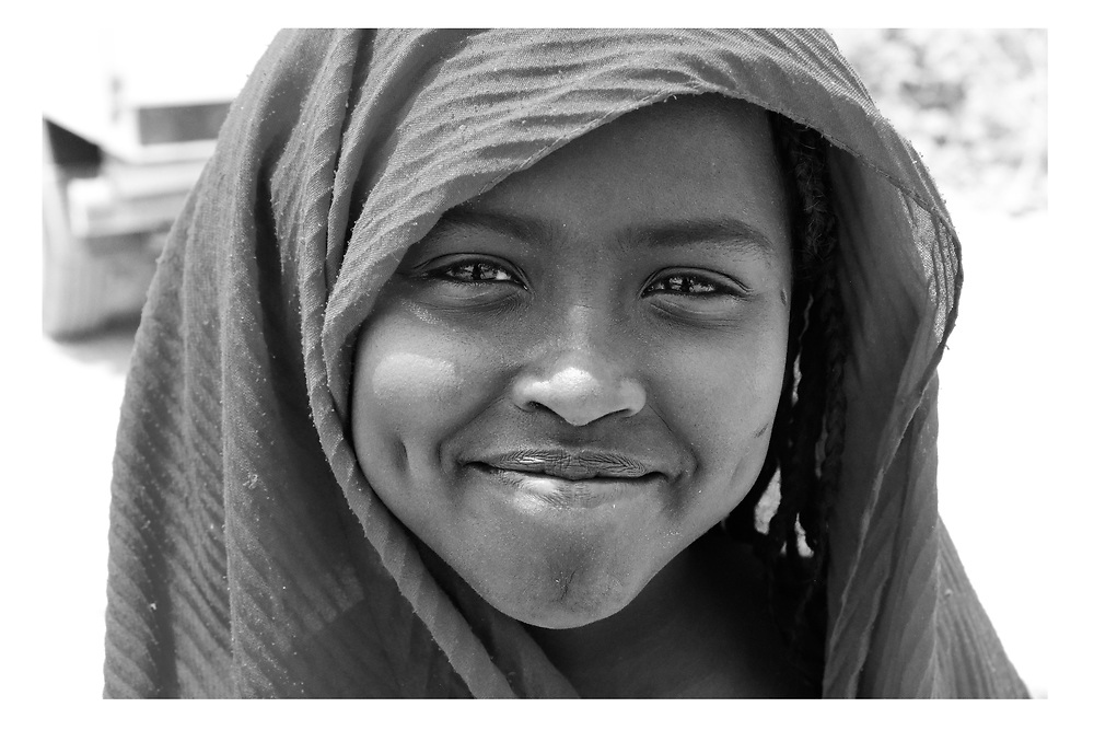 Smiling young girl shows her dimples Asaiyta Refugee Camp, Afar, Ethiopia 2016