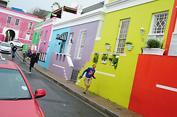 Cape Town - 180629 - Kids run down Chippini street in the Bo-Kaap. While the rain started pouring in Cape Town on Friday, the SA Weather Service has warned that an intense cold front is expected to land on Sunday and continue into Monday. Picture: Henk Kruger/ANA/African News Agency