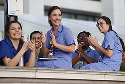 © Licensed to London News Pictures. 23/04/2020. London, UK. Hospital workers, nurses and doctors gather outside St Thomas'  Hospital at 8pm for the weekly Clap for Carers celebration. Lockdown continues throughout the UK in an attempt to stop the spread of the coronavirus Covid-19 virus. Photo credit: Peter Macdiarmid/LNP
