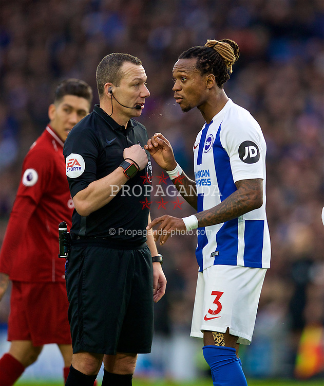 BRIGHTON AND HOVE, ENGLAND - Saturday, January 12, 2019: Brighton & Hove Albion's Gaëtan Bong is spoken to by referee Kevin Friend during the FA Premier League match between Brighton & Hove Albion FC and Liverpool FC at the American Express Community Stadium. (Pic by David Rawcliffe/Propaganda)