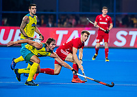 BHUBANESWAR, INDIA - Will Calnan (Eng) with Jeremy Hayward (Aus) England v Australia for the bronze medal during the Odisha World Cup Hockey for men  in the Kalinga Stadion.   COPYRIGHT KOEN SUYK