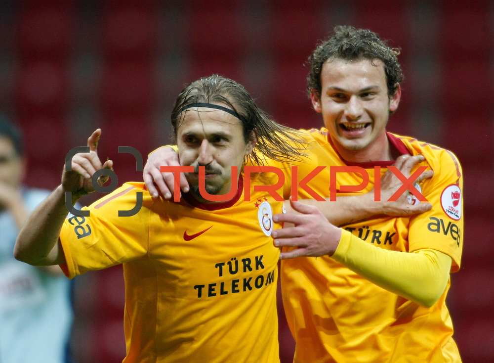 Galatasaray's Ayhan Akman (L) celebrate his goal during their Turkey Cup matchday 3 soccer match Galatasaray between AdanaDemirspor at the Turk Telekom Arena at Aslantepe in Istanbul Turkey on Tuesday 10 January 2012. Photo by TURKPIX