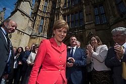 © London News Pictures. 11/05/2015. Leader of the SNP Nicola Sturgeon is applauded by 56 SNP Members of Parliament outside the St Stephens Entrance to the Houses of Parliament  as they arrive at Westminster following their election sucess. Photo credit: Ben Cawthra/LNP