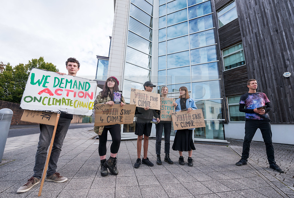 """© Licensed to London News Pictures. 30/08/2019. Bristol, UK. Campaigners dressed as characters from Star Wars hand out leaflets outside Aardman Animation Studios for the Extinction Rebellion Rebel Youth Alliance, The Film Industry Strikes Back event. Extinction Rebellion have formed an alliance with the Youth Strike for Climate and are asking the film industry for help after hearing Greta Thunberg's call """"We need everyone"""" for a general strike, the Global Climate Strike on 20 September. The Rebel Youth Alliance hopes the film, television and theatre industries and its trade unions BECTU and Equity will join them and together use the industry's position as a cultural leader to press for change to avoid the collapse of civilisation and the deaths of millions. Photo credit: Simon Chapman/LNP."""
